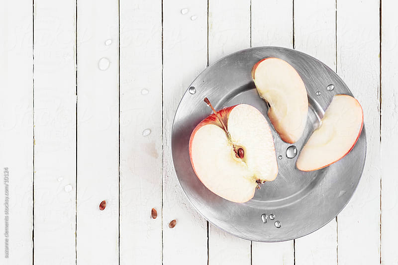 Fresh Sliced Organic Apple and Seeds by suzanne clements for Stocksy United