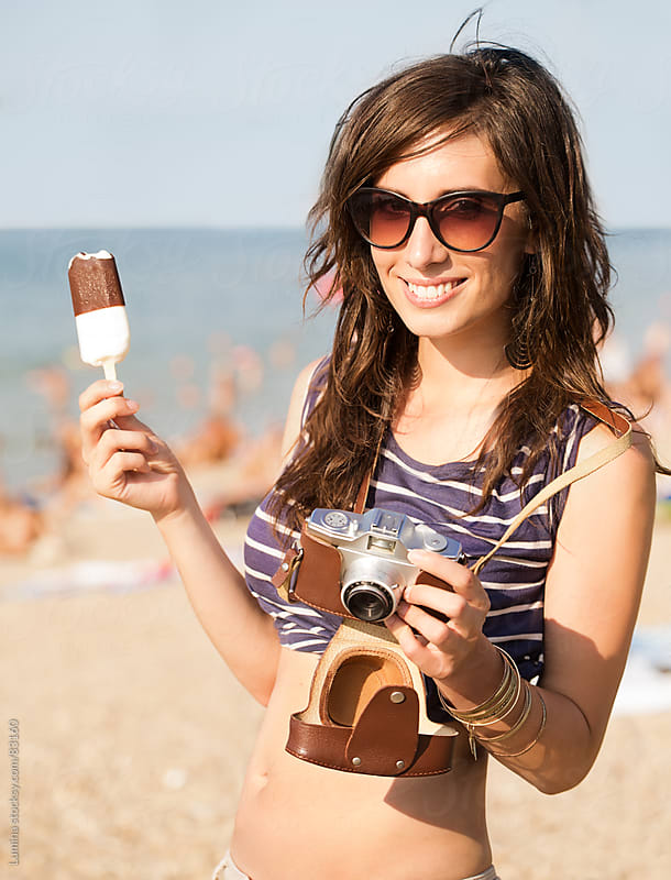 Woman Eating Ice-Cream on the Beach by Lumina for Stocksy United