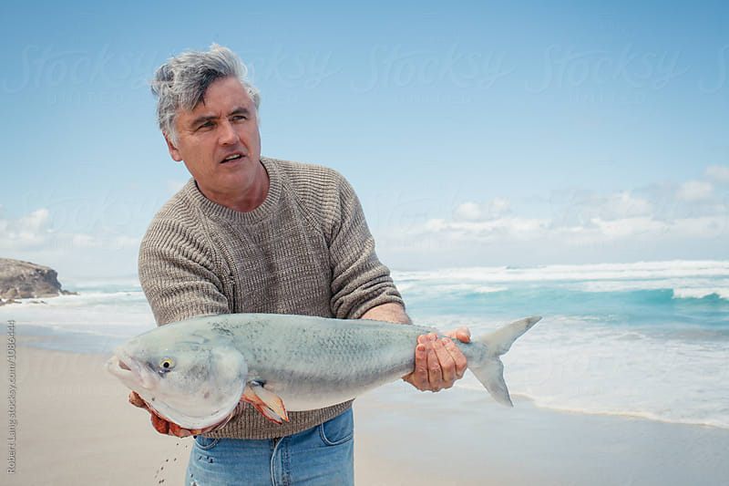 Recreational beach fishing, Australia by Robert Lang for Stocksy United