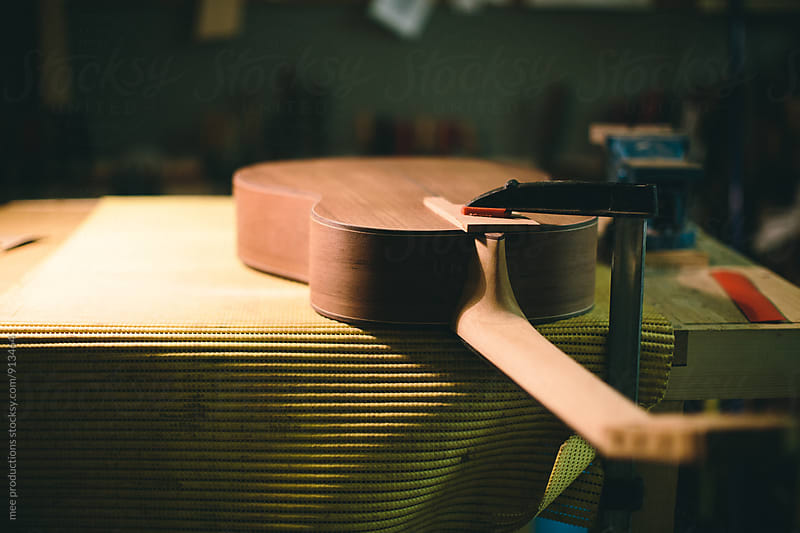 Young luthier building spanish guitars in his workshop by mee productions for Stocksy United