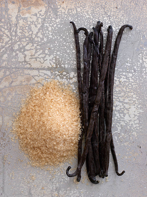 Vanilla beans and raw sugar by Daniel Hurst for Stocksy United