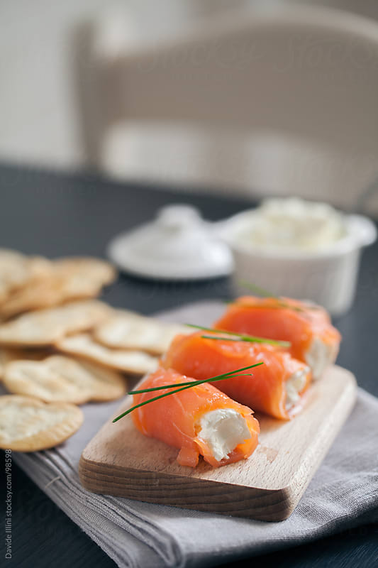 Smoked salmon rolls with cream cheese by Davide Illini for Stocksy United