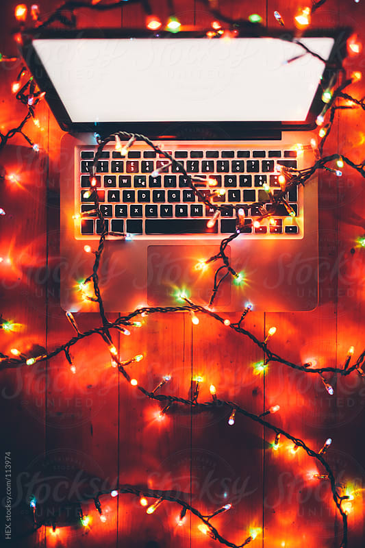 Computer With Christmas Light by HEX. for Stocksy United