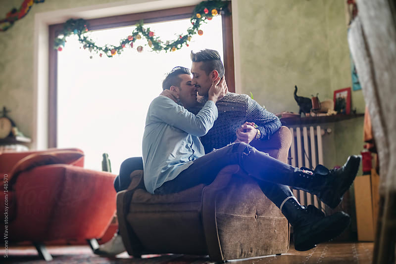 Affectionate gay couple together at home by GIC for Stocksy United