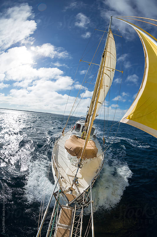 Sailing a yacht. by John White for Stocksy United