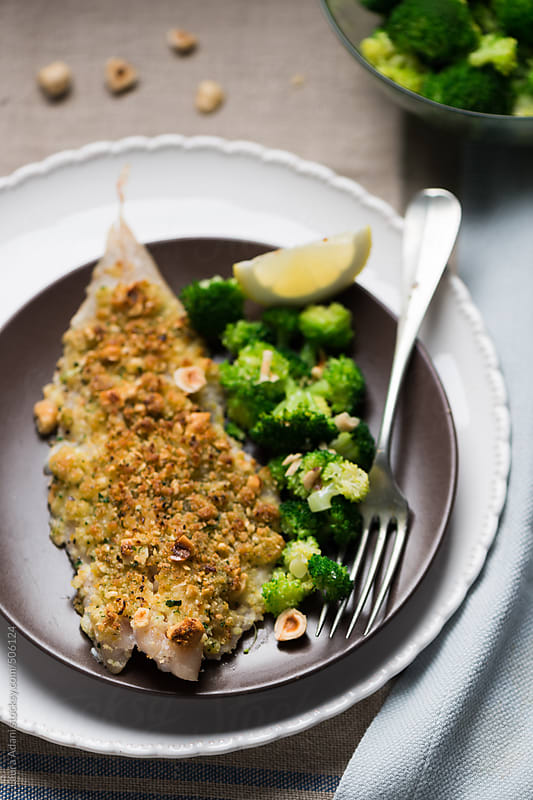 baked fillet of cod with hazelnut crumble by Laura Adani for Stocksy United