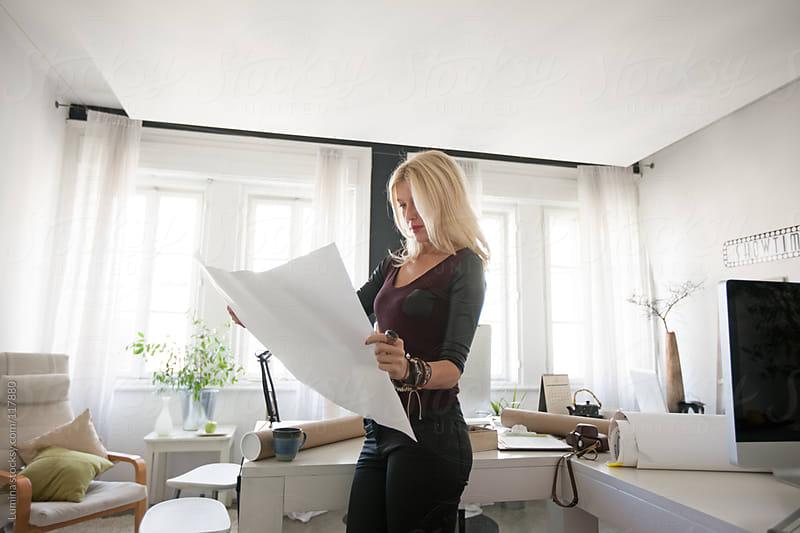 Architect Reading a Blueprint by Lumina for Stocksy United