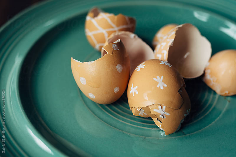 Brown egg shells with doodle decorations on them by Gabriel (Gabi) Bucataru for Stocksy United