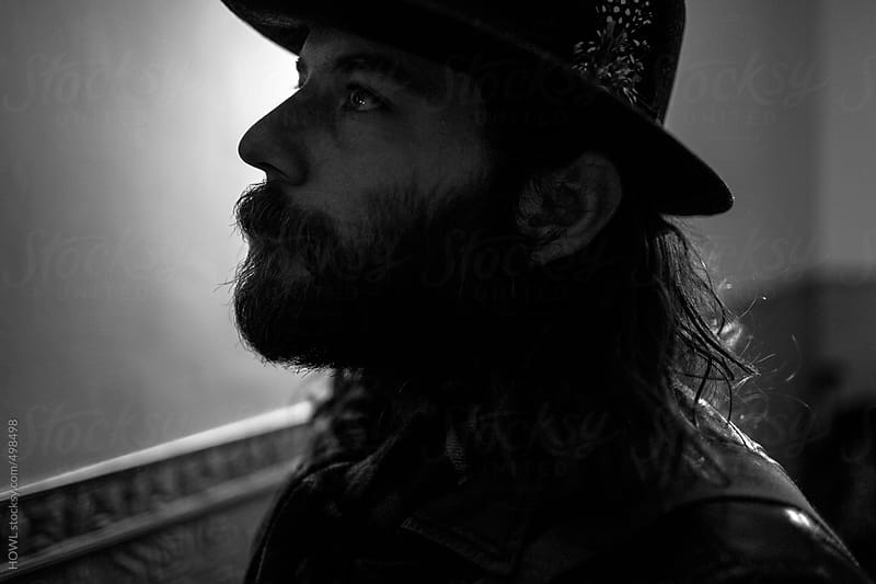A portrait of a serious young bearded man  by HOWL for Stocksy United