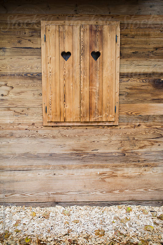 Wooden house and windows with cutout heart by Jovana Rikalo for Stocksy United