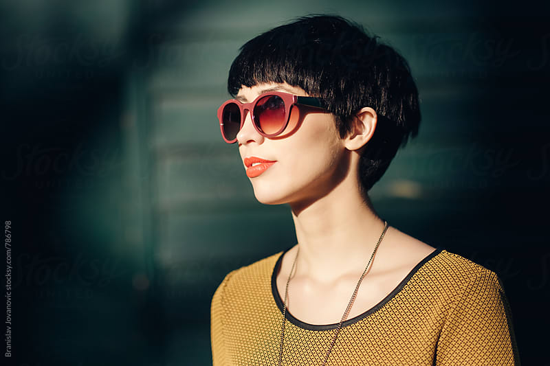 Portrait if a Stylish Short-Haired Woman with Sunglasses by Brkati Krokodil for Stocksy United