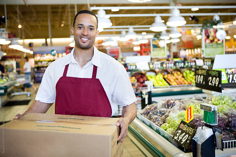 Supermarket: Happy Employee with Produce Box by Sean Locke for Stocksy United