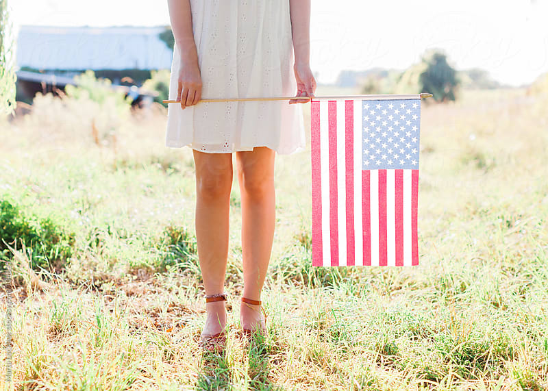 Teen girl with American Flag by Marta Locklear for Stocksy United