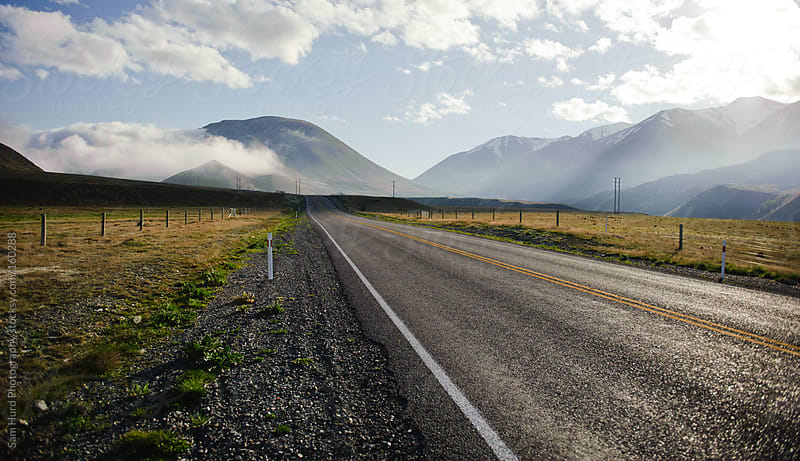 a foggy highway by Sam Hurd Photography for Stocksy United
