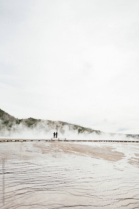 Tourists look at the Midway Geyser Basin in Yellowstone National Park by michela ravasio for Stocksy United