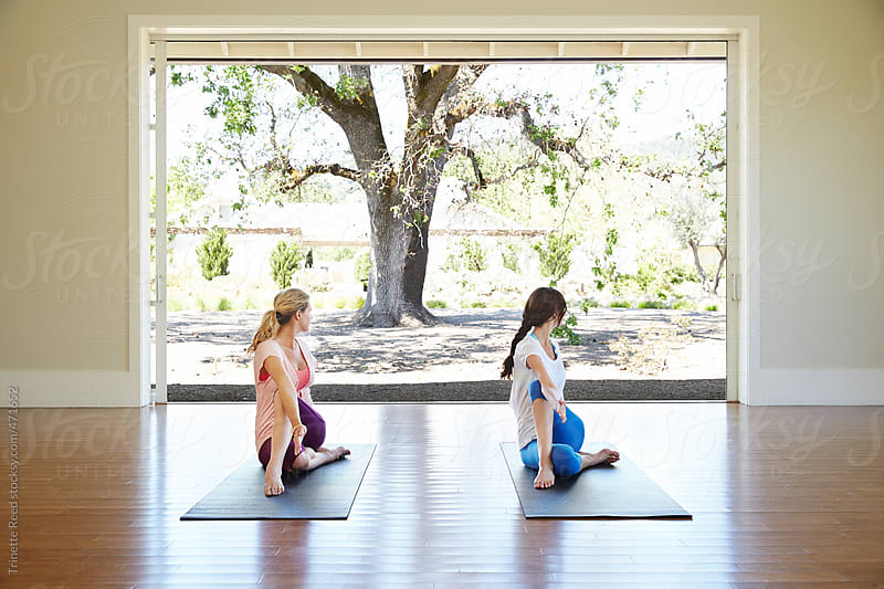 Friends doing yoga class at luxury resort by Trinette Reed for Stocksy United