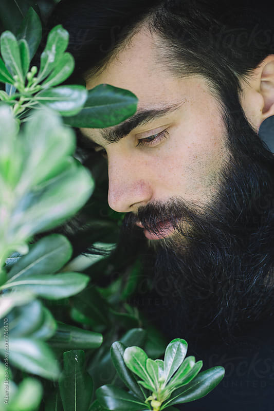 Portrait of Young man with beard by Alberto Bogo for Stocksy United