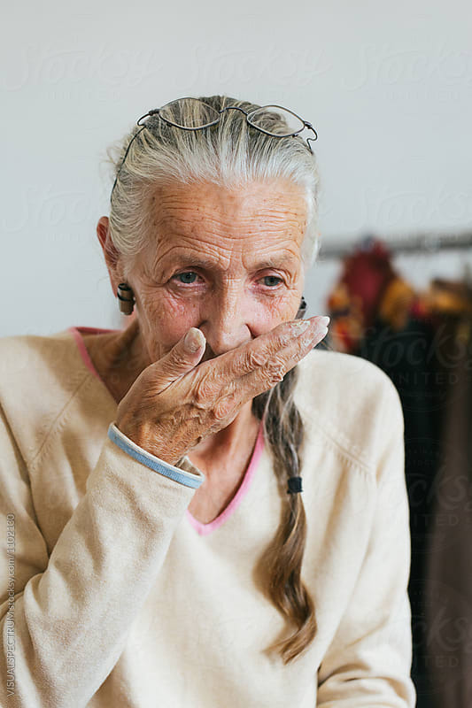 Environmental Portrait of Senior Woman with Grey Hair Smelling R by Julien L. Balmer for Stocksy United