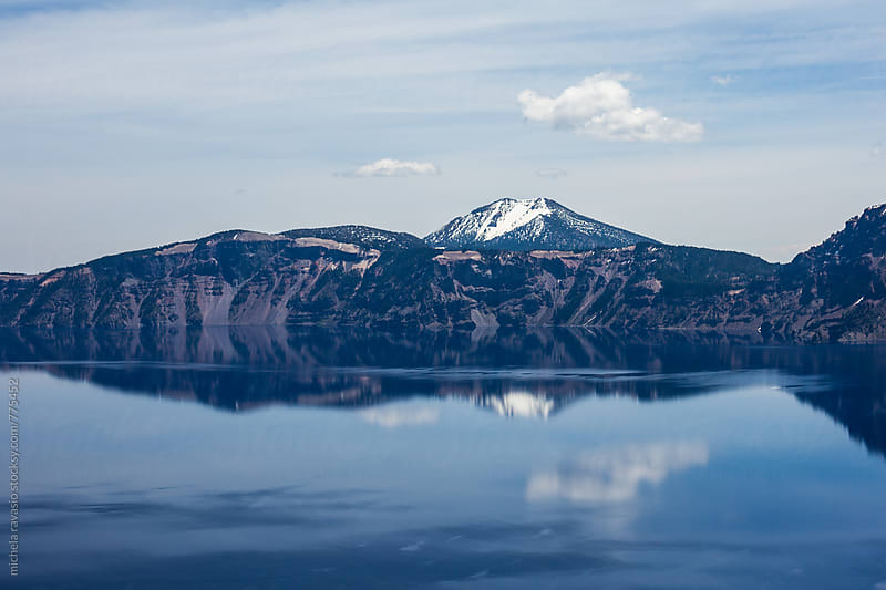 Mountains reflected in the lake, Crater Lake National Park by michela ravasio for Stocksy United