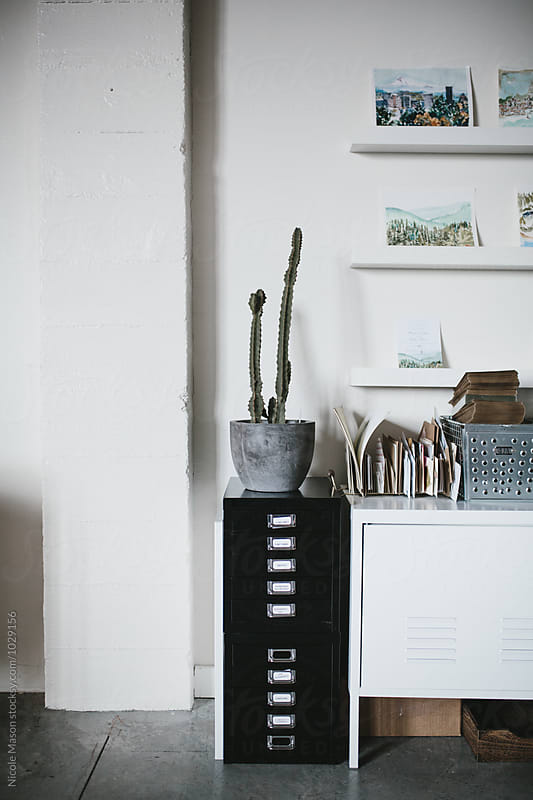 creative office space with plant and artwork by Nicole Mason for Stocksy United