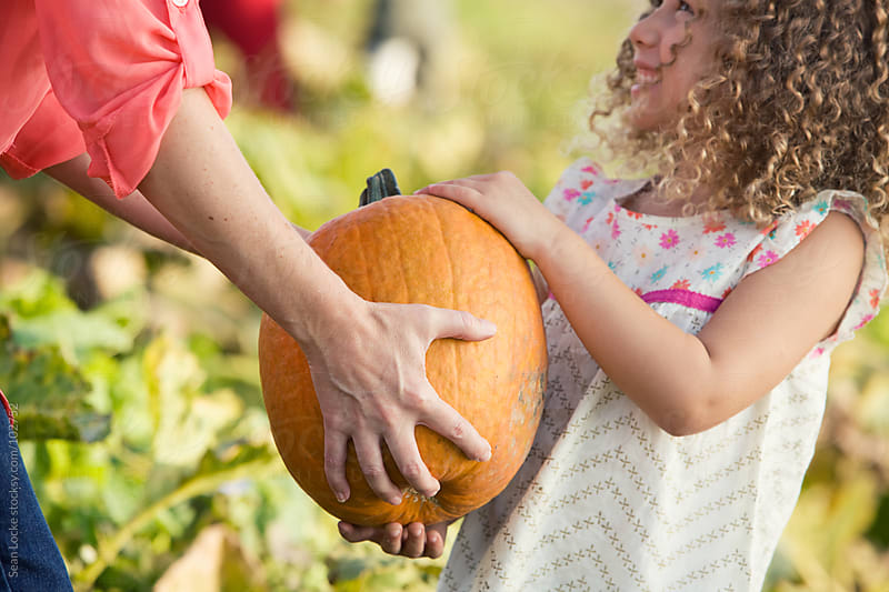 Pumpkins: Mother and Daughter Pick Pumpkin by Sean Locke for Stocksy United