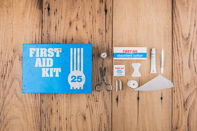 Vintage First Aid Kit Against Wood by suzanne clements for Stocksy United