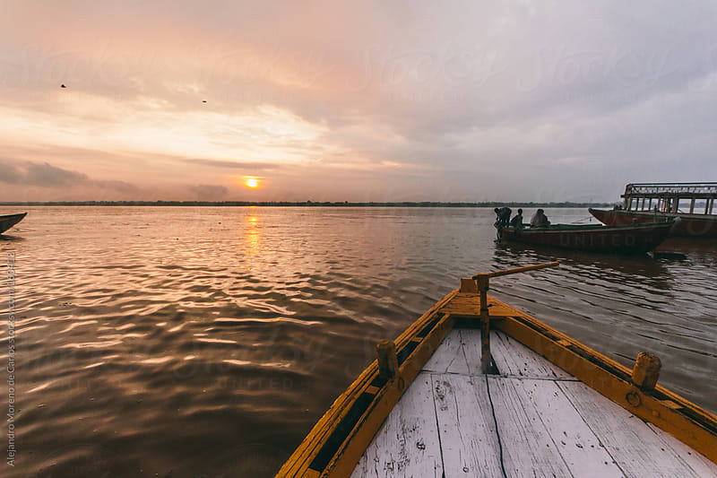 Boat pov shot at Ganges River at sunrise, Varanasi, India by Alejandro Moreno de Carlos for Stocksy United