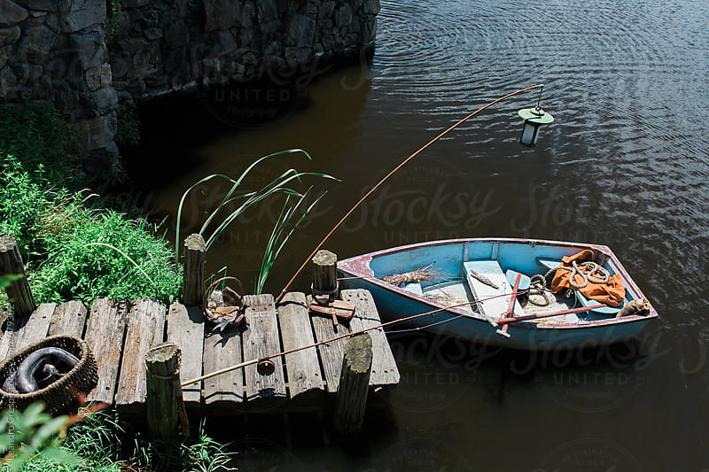 A fisherman small boat moored at a dock by Leandro Crespi for Stocksy United