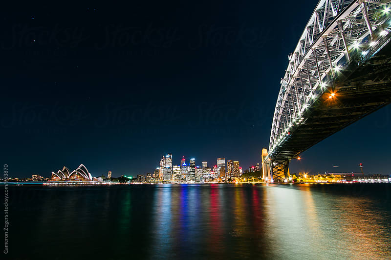 Sydney Harbour at Night by Cameron Zegers for Stocksy United