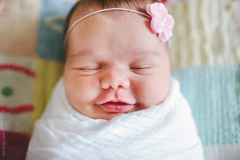 baby girl smiling by Erin Drago for Stocksy United