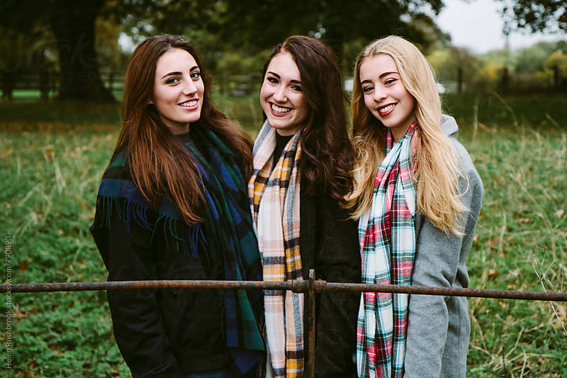 Three teenage girls outdoors by Helen Rushbrook for Stocksy United