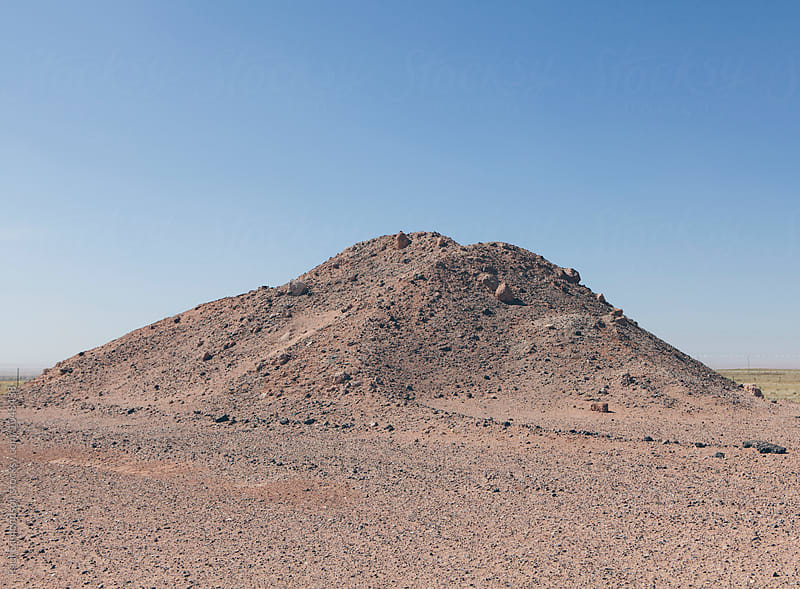 Gravel pile on desert by Paul Edmondson for Stocksy United