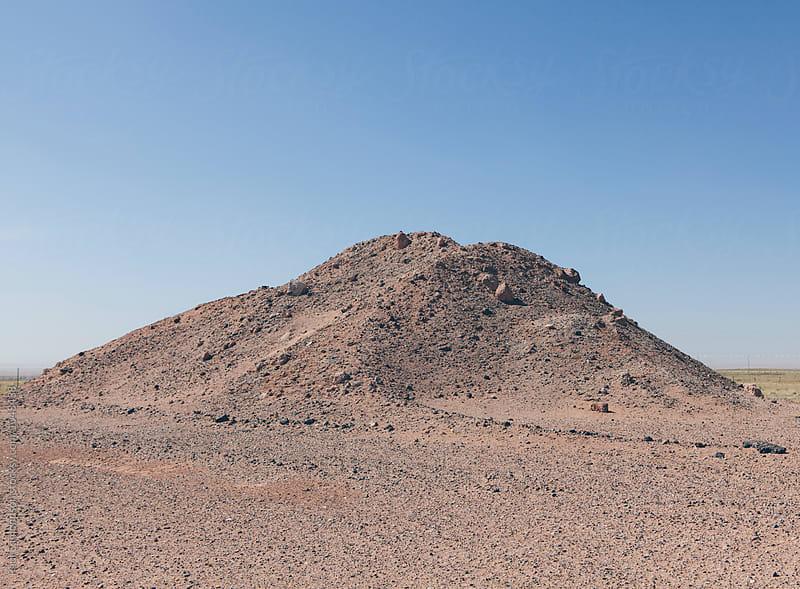 Gravel pile on desert by Paul Edmondson for Stocksy United