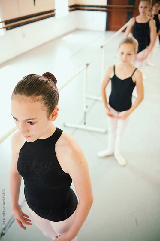 Ballet: Girls Standing By Ballet Barre by Sean Locke for Stocksy United