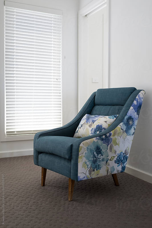 Re-upholstered vintage chair by Rowena Naylor for Stocksy United