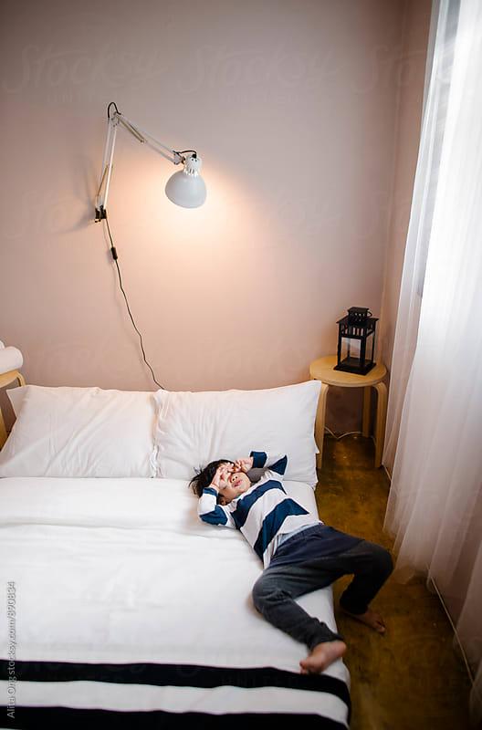 Sleepy little boy in bedroom by Alita Ong for Stocksy United
