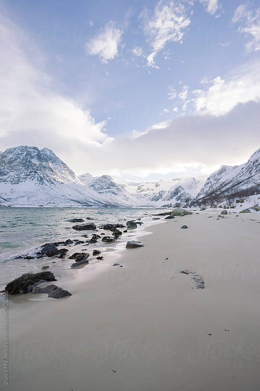 nordic fjord in winter by Juri Pozzi for Stocksy United