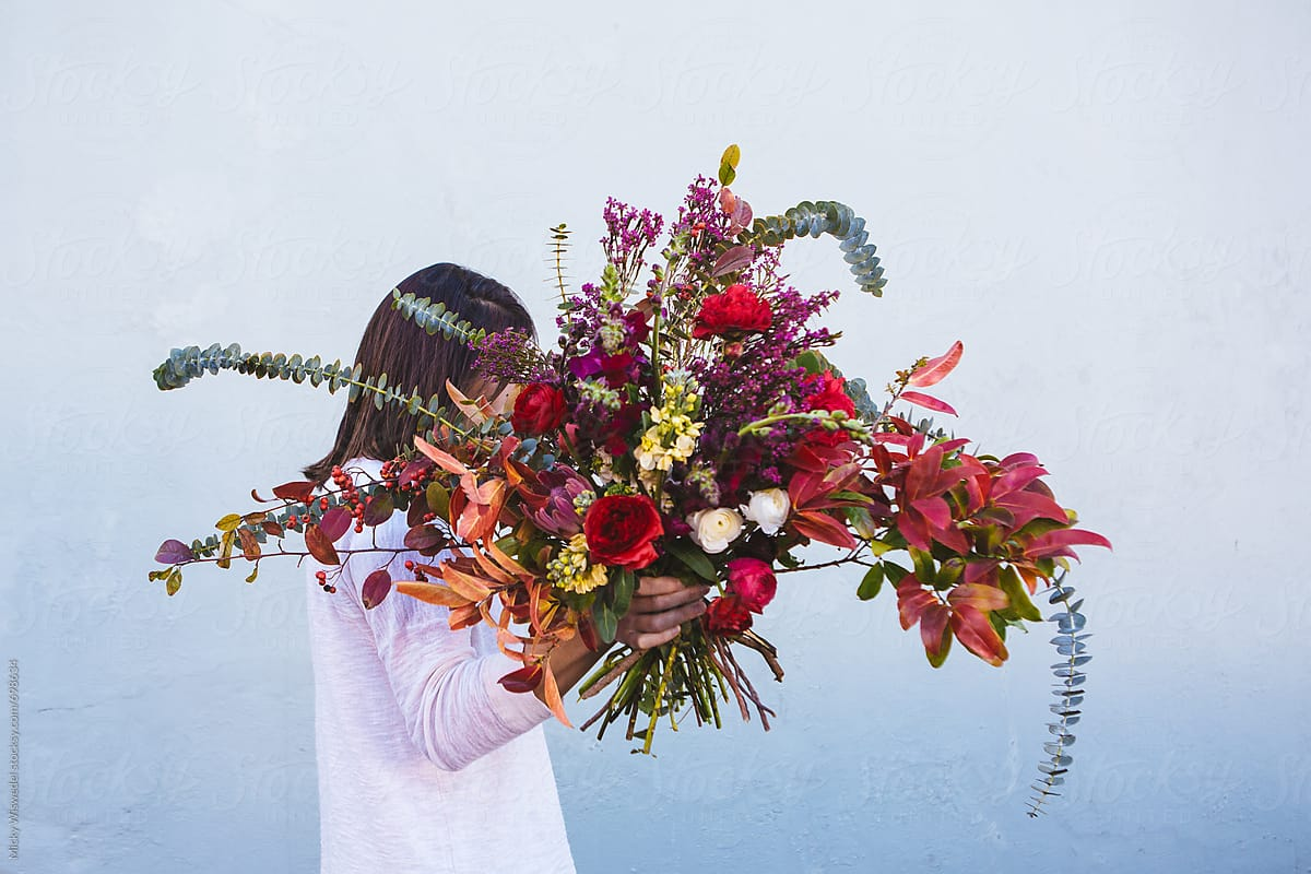 Woman Holding A Big Bouquet Of Wild Flowers Stocksy United