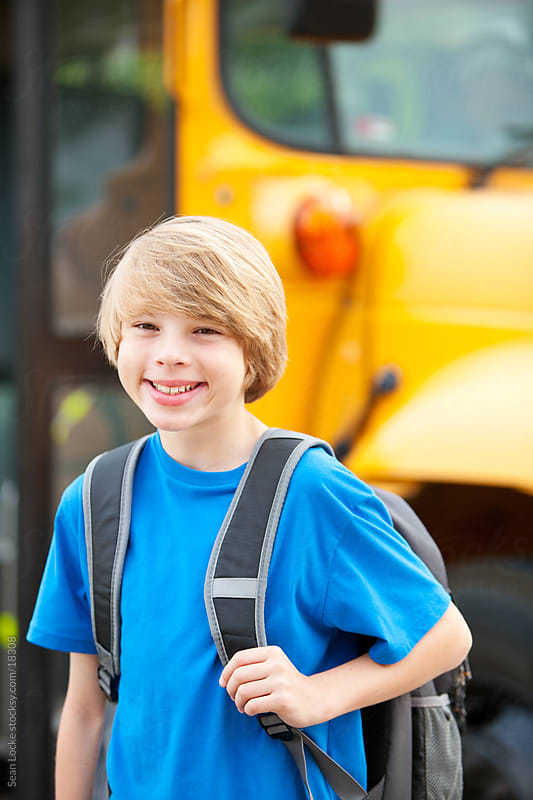 School Bus: Cool Boy with Backpack by Sean Locke for Stocksy United