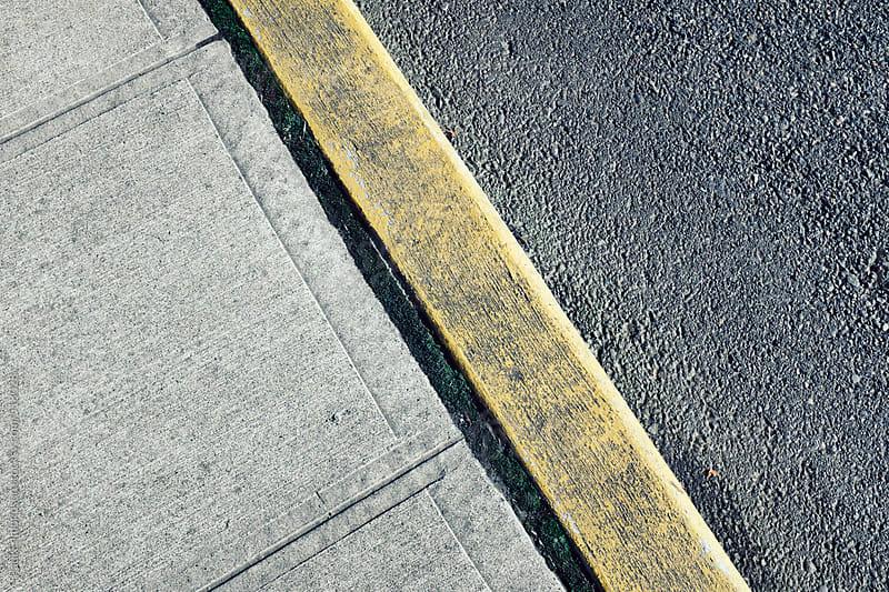 Painted curb along sidewalk and urban street by Paul Edmondson for Stocksy United
