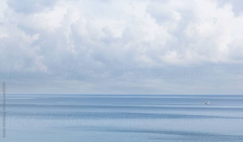 Sea and sky with clouds background by Robert Kohlhuber for Stocksy United