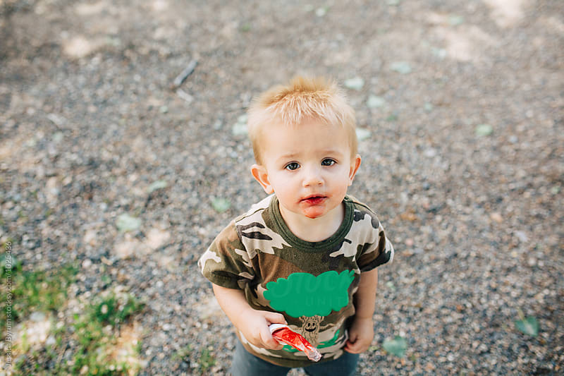 Toddler boy with popsicle by Jessica Byrum for Stocksy United