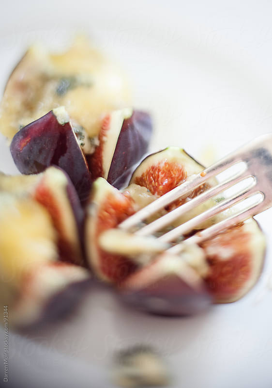 Figs and cheese. by Darren Muir for Stocksy United