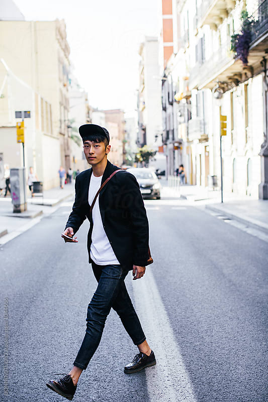 Casual asian businessman in the street. by BONNINSTUDIO for Stocksy United