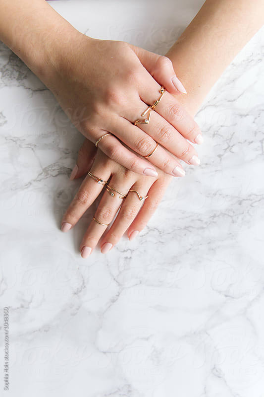 Hand with gold rings by Sophia Hsin for Stocksy United