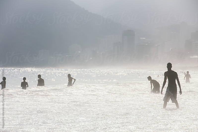 Silhouette of people on the beach. Ipanema beach in rio de Janeiro, Brazil by Alejandro Moreno de Carlos for Stocksy United