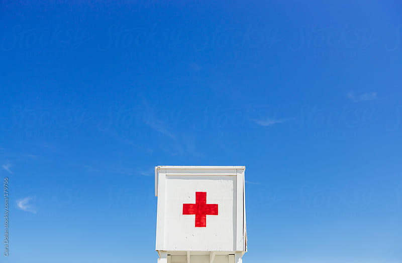 Lifeguard chair at a public beach on a beautiful summer day by Cara Dolan for Stocksy United