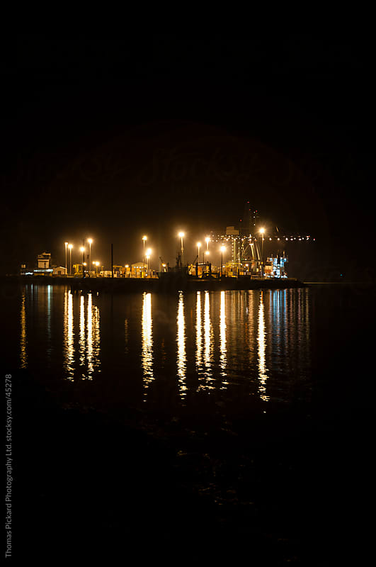 Industrial port facility at night, New Zealand. by Thomas Pickard for Stocksy United