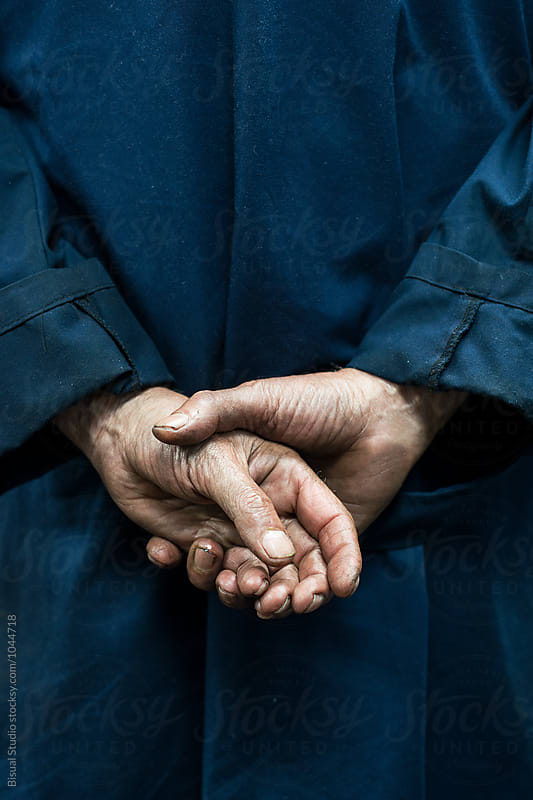 Hands of a senior mechanic by Bisual Studio for Stocksy United