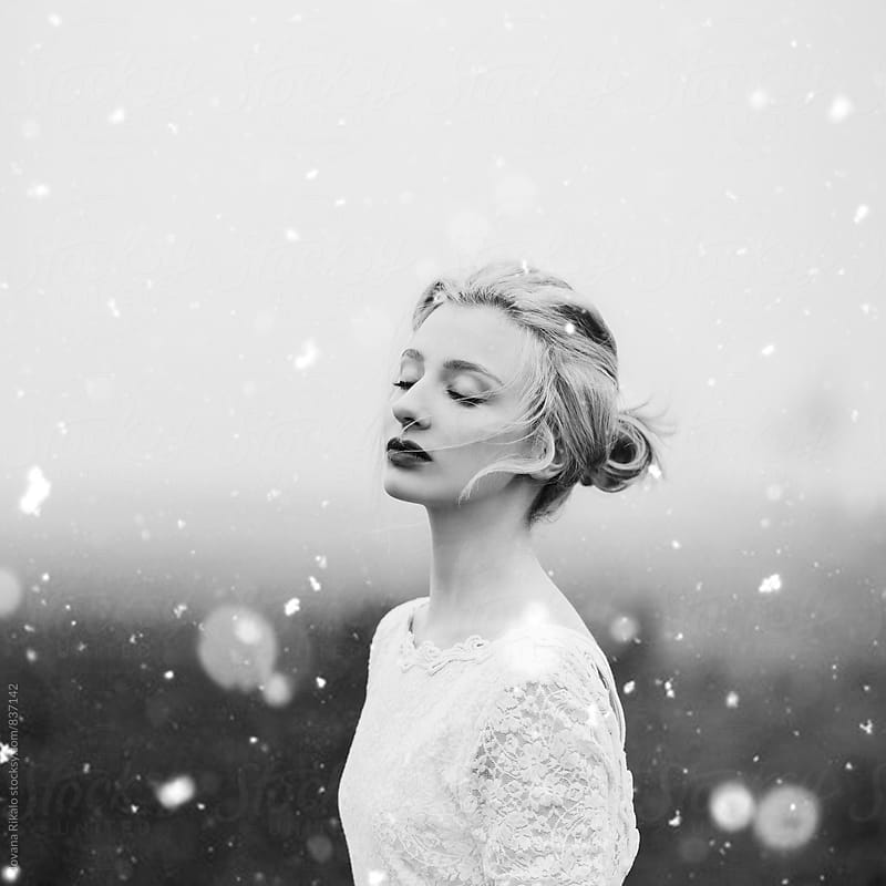 Portrait of a beautiful young woman and a snow by Jovana Rikalo for Stocksy United
